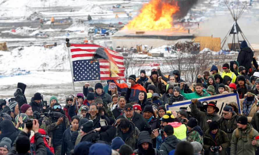 Opponents of the Dakota Access oil pipeline march out of their main camp near Cannon Ball, North Dakota, in February 2017.