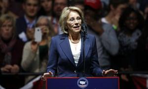 Betsy DeVos, Trump's choice for education secretary, has fought for a school voucher system.
