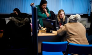 Staff advising a client at the Refugee and Migrant Centre in Wolverhampton