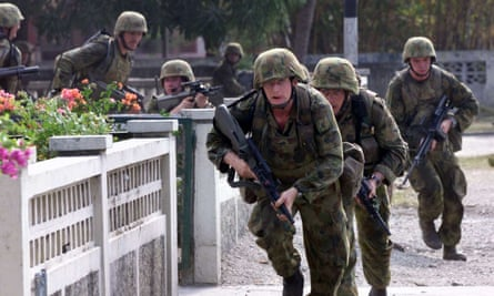 Australian troops in the Timorese capital of Dili in the first week of the Australia-led mission, 24 September 1999.