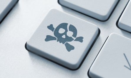 computer keyboard with pirate skull and crossbones key