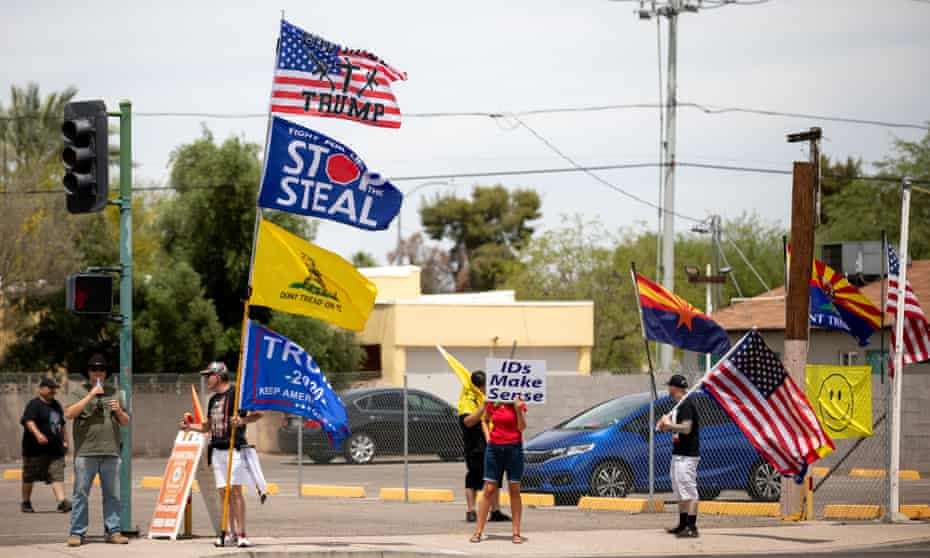 Protesters supporting Trump gather outside the Veterans Memorial Coliseum in Phoenix on 1 May.