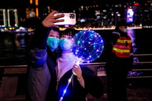 A couple take a selfie in Hong Kong