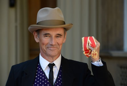 Sir Mark Rylance holds his award after he was appointed a Knight Bachelor for services to drama during a ceremony at Buckingham Palace.