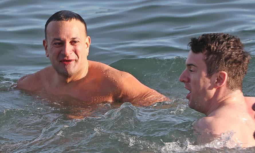 The taoiseach, Leo Varadkar, and his partner Matt Barrett take part in the annual Christmas Day swim at the Forty Foot bathing spot in Sandycove, Dublin.