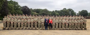 Theresa May and Donald Trump pose for a photograph at Royal Military Academy Sandhurst.