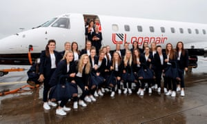 Scotland's Women stop for a picture outside their plane before they departed Edinburgh airport on Wednesday.