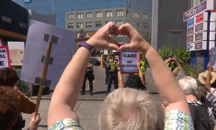 People protest in Melbourne in late February outside a hotel where refugees who have been medevaced to Australia from offshore detention are being kept held by the Australian government.