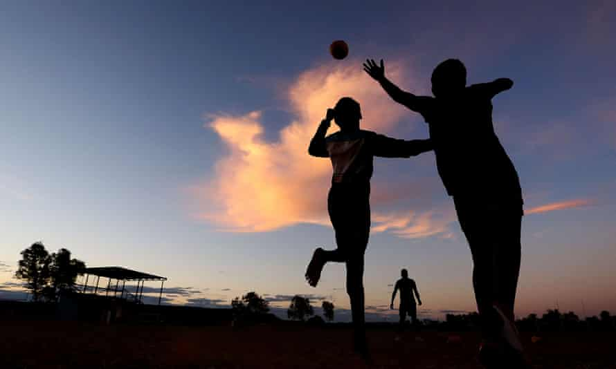 Indigenous footballers contest for the ball during a Santa Teresa Football Club training session on May 28, 2014 in Alice Springs, Australia.