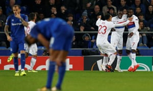 Lyon's Bertrand Traoré celebrates what turned out to be the winner for his team as Everton players and fans alike look dejected.