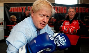 """Boris Johnson wears boxing gloves emblazoned with """"Get Brexit Done"""""""