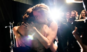 Emma Stone and Brie Larson embrace at the Oscars.