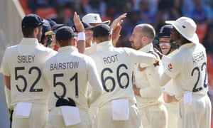 Jack Leach is congratulated by his England team mates after taking the wicket of Rohit Sharma.