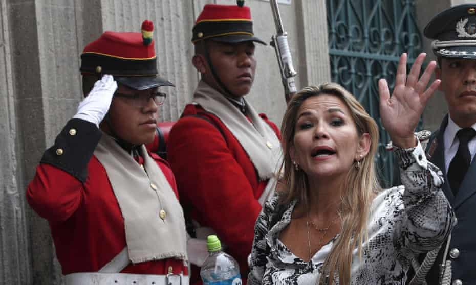 Jeanine Áñez, the opposition senator who has claimed Bolivia's interim presidency, arrives at the government palace in La Paz.