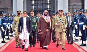 Saudi Arabian Crown Prince Mohammed bin Salman is flanked by Pakistan's Prime Minister Imran Khan and Army Chief General Qamar Javed Bajwa in Islamabad.