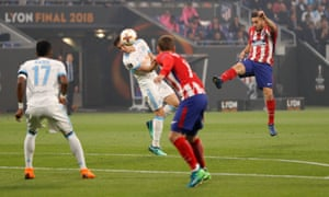 Atletico Madrid's Koke shoots at goal as Marseille's Florian Thauvin attempts to block.