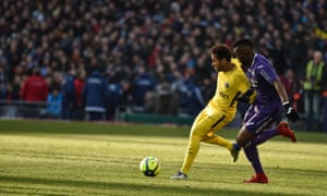Yaya Sanogo tussles with Neymar in PSG's 1-0 win over Toulouse.