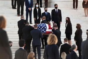 People watch as the casket of the Justice Ruth Bader Ginsburg arrives at the supreme court.