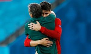 Spain's Alvaro Morata celebrates scoring their first goal with manager Luis Enrique.