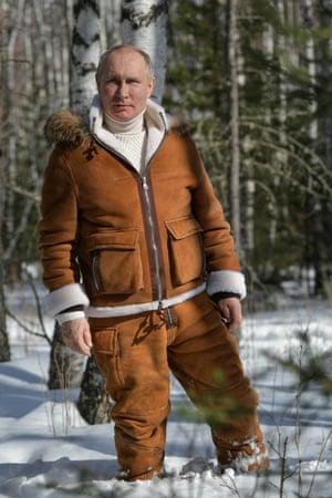 Putin hikes through the forest.