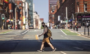 pedestrian with mask in central Manchester