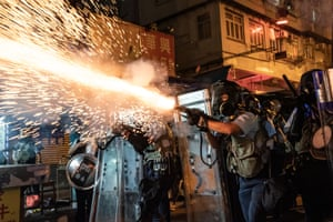 Police fire teargas to clear pro-democracy protesters during a demonstration on Hungry Ghost festival day in the Sham Shui Po district.