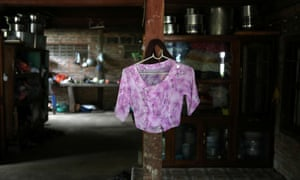 A blouse belonging to Kyu Kyu Win, who says she is going through a divorce with an abusive husband, hangs on a shelf at a house in Dawei, Myanmar