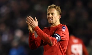 Lucas applauds fans after an FA Cup tie against Plymouth in January, when he wore the captain's armband.