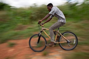 Clement Adade rides one of the bamboo bicycles.