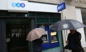 People walk past a TSB branch