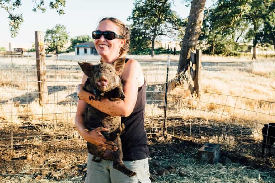 Megan Brown holds one of her sows.