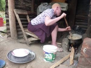 Cooking ugali, a cornmeal porridge in a village home.