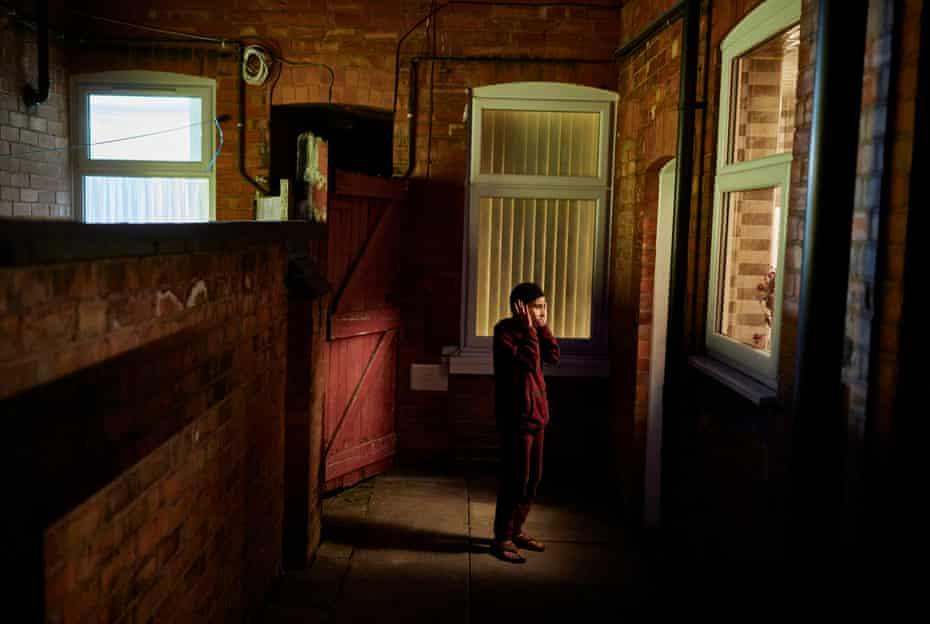 Shahmir Amir, 10, recites the adhan (the Islamic call to prayer) in his back garden in Leicester during Ramadan