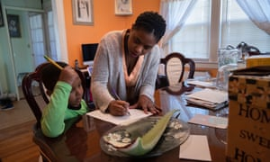 Geri Andre-Major helps her son Max, 5, with his school work in Mount Vernon, New York. Andre-Major said she was furloughed as a preschool teacher and her husband was laid off as a chef consultant.