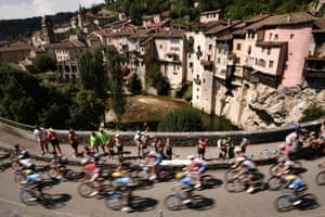 The pack rides through the village of Pont-en-Royans during the 13th stage between Le Bourg-d'Oisans and Valence