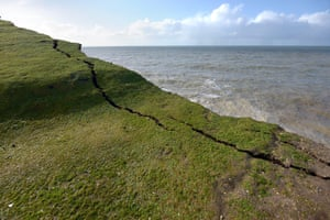 Birling Gap chalk cliffs in East Sussex show cracks due to erosion.