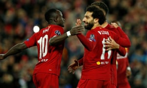 Liverpool's Mohamed Salah celebrates scoring their fourth goal with teammates.