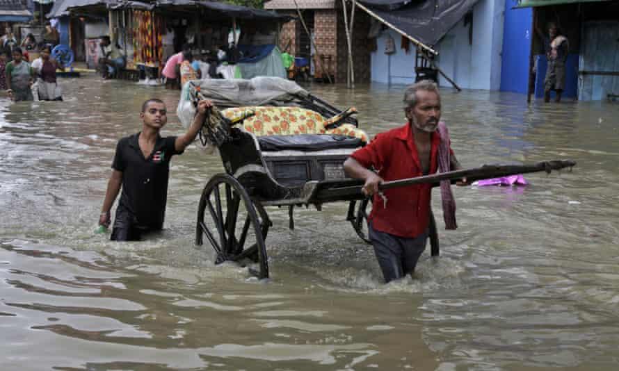 Indian rickshaw flood Kolkata monsoon rain