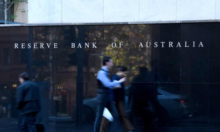 People walk past the Reserve Bank of Australia building in Sydney