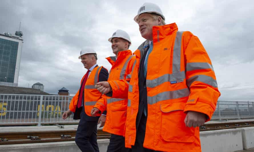 Boris Johnson with Barry White, chief executive of Transport for the North, and the Northern Powerhouse minister Jake Berry in Stretford, Greater Manchester.