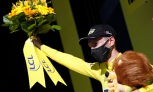 Adam Yates celebrates keeping the yellow jersey after stage six