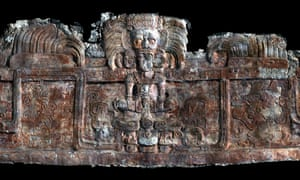 A 3D scan of the frieze decorating a tomb-containing building at Holmul, showing a king wearing an avian sun god headdress emerging from a sacred mountain spirit head amid feathered serpents.