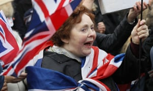 a woman draped in a union flag at a pro-brexit rally