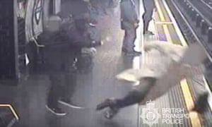 A CCTV image of Sir Robert Malpas being pushed on to the tracks