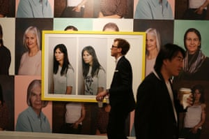 A viewer walks past a work by Gillian Wearing.