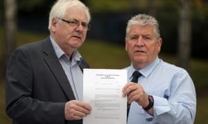 Michael Gallagher (left) and Stanley McComb hold the writ against George Hamilton