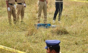 Police guard the body of a gang rape suspect in Shadnagar, near Hyderabad.