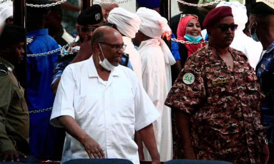 Sudan's former president Omar al-Bashir (centre-left) during his trial in the capital, Khartoum, on 3 November.