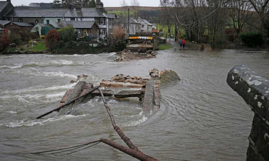 People look across Pooley Bridge in Ullswater, Cumbria, as Storm Frank battered the UK.