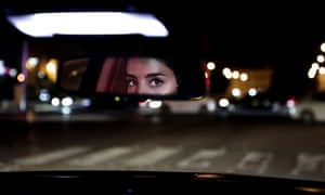 Hessah al-Ajaji drives her car down the capital's busy Tahlia Street after midnight for the first time, in Riyadh, Saudi Arabia.